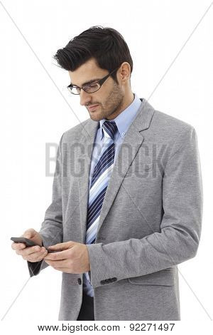 Young businessman writing text message on mobilephone.