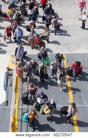 Passengers Board The Ship At The Port Of Paros In Greece.