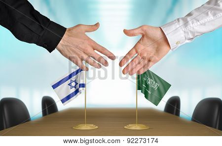 Israel and Saudi Arabia diplomats agreeing on a deal