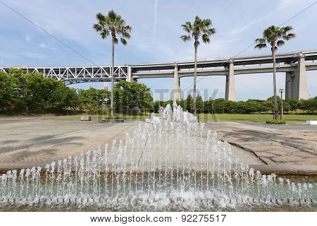 Park features fountain, Highway