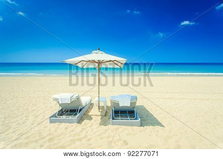 Two Sunbed And One Umbrella On The Beach