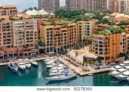 MONTE CARLO, MONACO - JULY 13, 2013: View on small marina and modern building of Monaco - principality on French Riviera, governed under a form of constitutional monarchy by Prince Albert II .