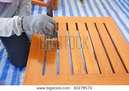 Brush In Hand And Painting On The Wooden Furniture