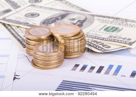 Coins And Dollar Banknotes On Bar Chart Graphics