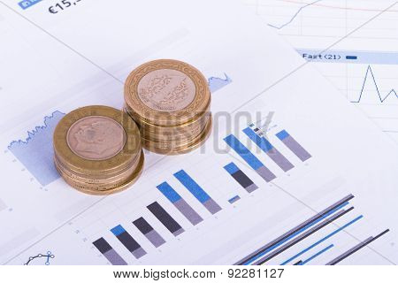 Coins On Chart Graphs And Financial Data