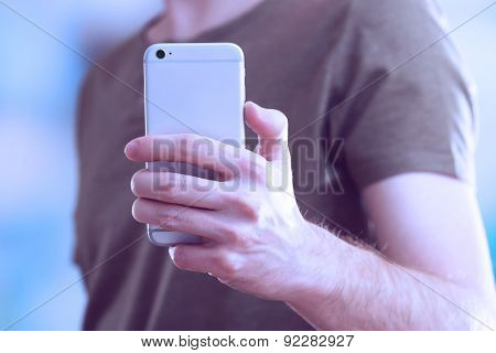 Man using mobile smart phone close-up