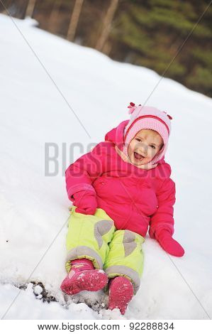 Girl Sits On Snow