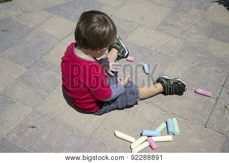 Young Boy Playing With Chalk