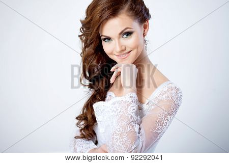 Portrait Of Happy Bride In Wedding Dress, Looking At The Camera