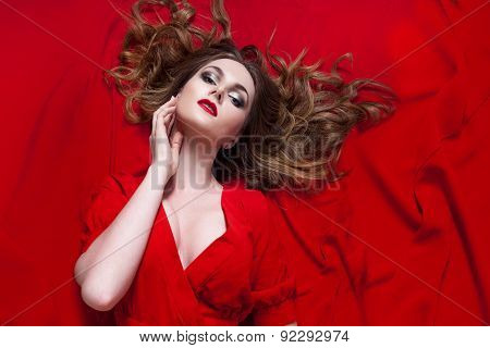 Woman In Red Dress Posing With Waving Fabric, Horizontally
