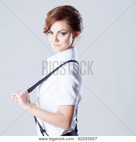 Successful Business Woman, Pulls Suspenders And Looking Into The Frame