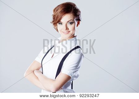 Successful Business Woman, In Shirt On White Background, Pants With Suspenders