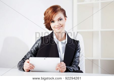 Successful Business Woman With Tablet  Looking Confident And Smiling