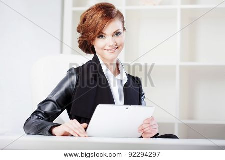 Successful Business Woman With Tablet In Hand Looking Confident And Smiling