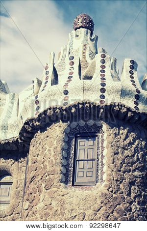 The roof of a gingerbread house in the Park Guell - vintage photo