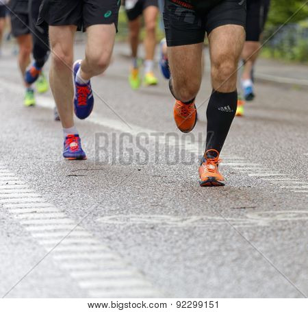Close up of a group of running feet and legs