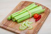 stock photo of celery  - Fresh Green Celery sticks on the wood background - JPG