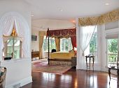 foto of master bedroom  - a beautiful master bedroom suite with custom features and architectural detail
