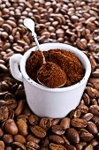 stock photo of coffee grounds  - Ground coffee rests in a ceramic Cup - JPG