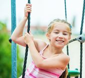 picture of playground  - cute beautiful smiling little girl on a playground - JPG