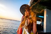 stock photo of boat  - Happy woman enjoying the sea from ferry boat crossing Bosphorus in Istanbul - JPG