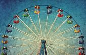 stock photo of color wheel  - Vintage grunge background with colorful ferris wheel - JPG