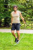 foto of roping  - Young athlete jumping rope outdoor - JPG