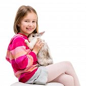 image of rabbit year  - cute  girl in a crimson sweater  with baby rabbit isolated over white background close - JPG
