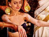 pic of panchakarma  - Woman having Ayurvedic spa treatment - JPG