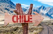 stock photo of tierra  - Chile wooden sign with Cordillera background - JPG