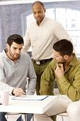 picture of work crew  - Young businessmen working in team - JPG