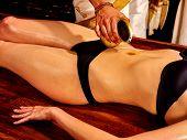 stock photo of panchakarma  - Young woman having stomach Ayurveda spa treatment - JPG