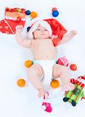 image of new years baby  - The image of the kid lying among New Year - JPG