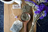 foto of peppermint  - peppermint tea on wooden board background decorated with purple flowers - JPG