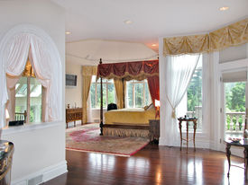 image of master bedroom  - a beautiful master bedroom suite with custom features and architectural detail