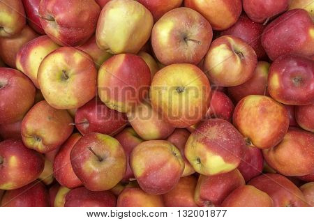 Background of fresh ripe red yellow apples