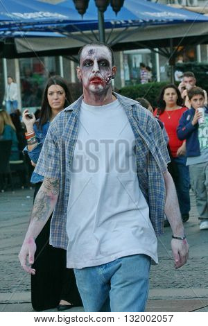 BELGRADE, SERBIA - OCTOBER 21: Man with mask poses in Zombie walk within reeling of the Festival of Serbian fiction movies October 21 2012 in Belgrade Serbia