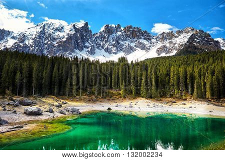 Perfectly clear emerald lake in Dolomites