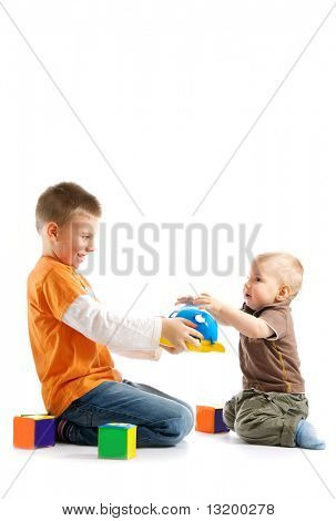 Two kids playing together over white background