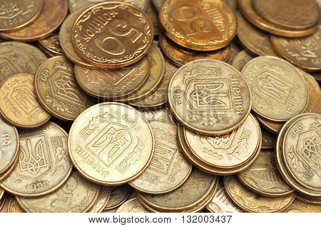 Many Coins On Wood Table. Ukrainian Coins
