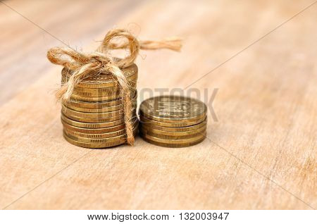 Golden Coins With Rope On Wood Table