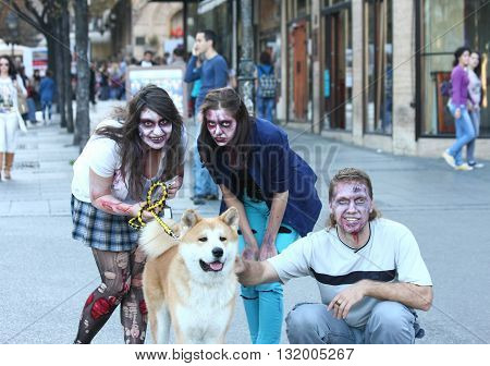 BELGRADE,SERBIA - OCTOBER 21: People with masks pose in Zombie walk within reeling of the Festival of Serbian fiction movies October 21 2012 in Belgrade Serbia