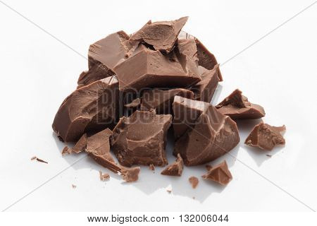Pieces of milk chocolate isolated on white