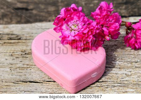 Soap and flower on the wooden background