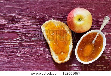Useful toast with apple jam on a wooden background. Homemade jam. Top view .Organic food. Copy space for you text