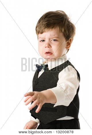 Handsome crying little boy in classic suite. Isolated on white background