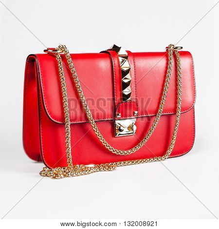 Red fashion woman clutch with the golden furniture