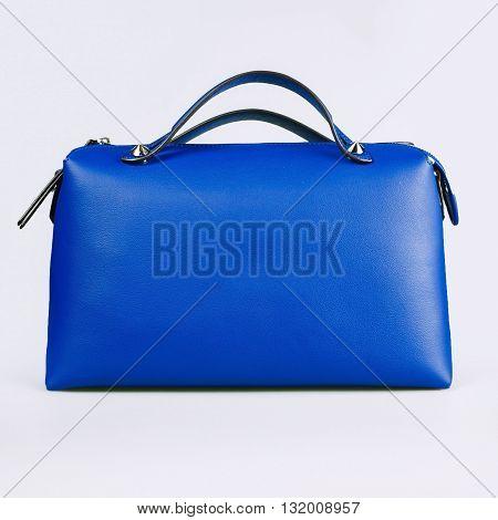 blue female bag on a white background