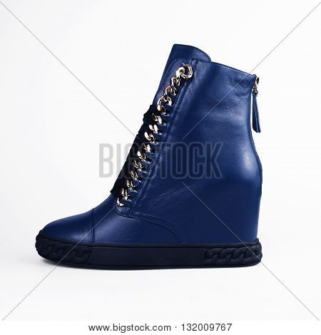 blue high heels boots in a white background