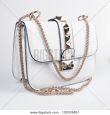 New white womens bag with black strip isolated on white background.
